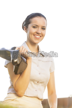 portrait of happy young businesswoman holding