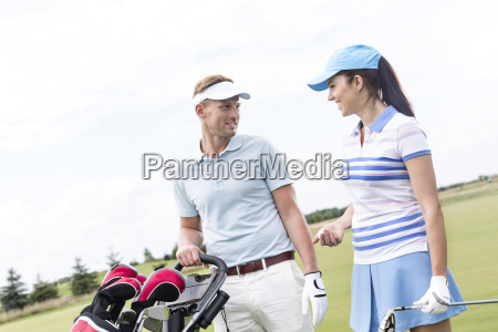 happy man and woman conversing at