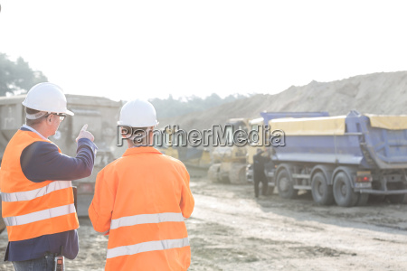 supervisor explaining plan to colleague at
