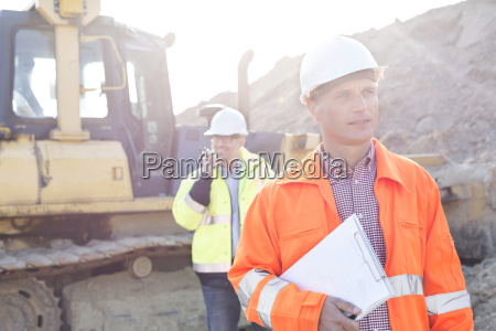 engineer holding clipboard on construction site