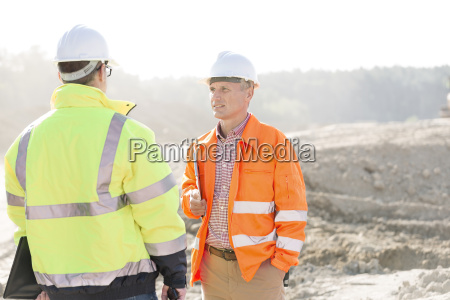 supervisors discussing at construction site on