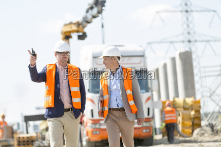 supervisors discussing at construction site
