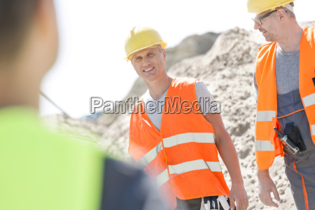 happy supervisor with colleague at construction