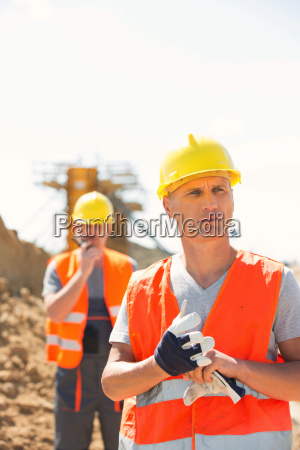 male worker standing at construction site