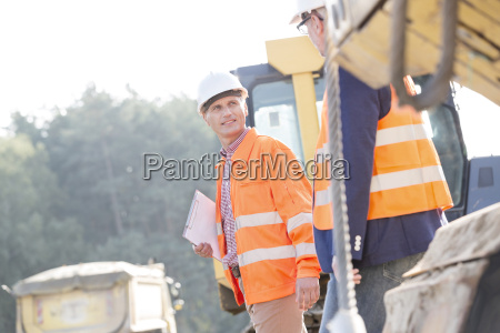 supervisors discussing while walking at construction