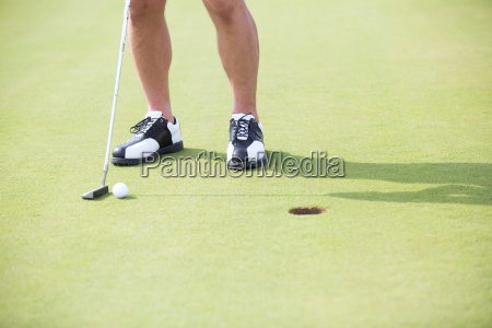 low section of man with golf