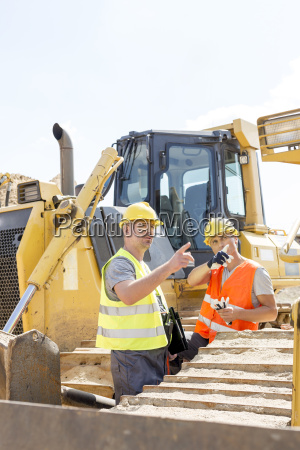 engineers pointing while discussing at construction