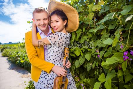 portrait of happy couple embracing by