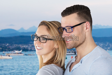 stylish young couple wearing eyeglasses