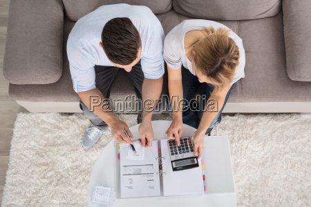 overhead view of a couple calculating
