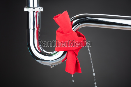 red cloth tied on leakage pipe