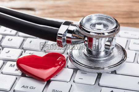 stethoscope and heart shape on keyboard