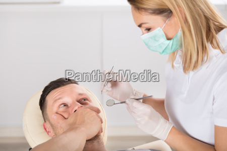 young man scared of dentist