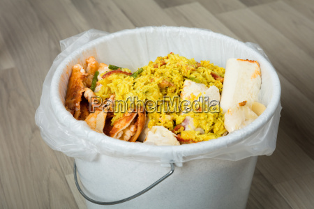 leftover food in trash bin