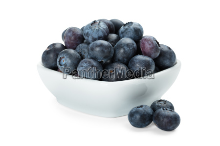 heap of fresh blueberries in white