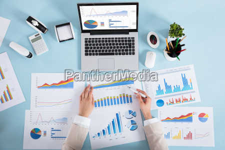 businesswoman analyzing graph in office