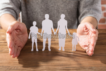 woman protecting family of white paper