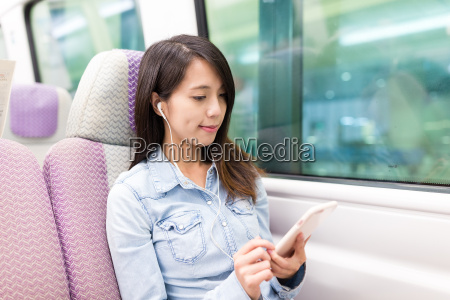 woman listen to song inside train
