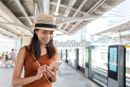 woman using cellphone in bangkok city