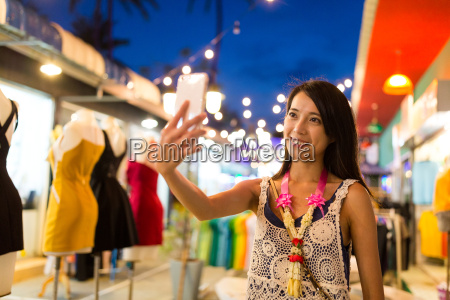 woman visiting night market and taking
