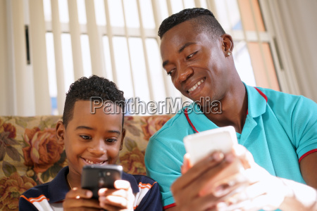 black man teaching mobile telephone technology