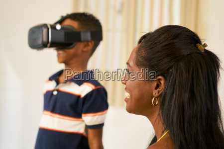 happy black family playing with virtual