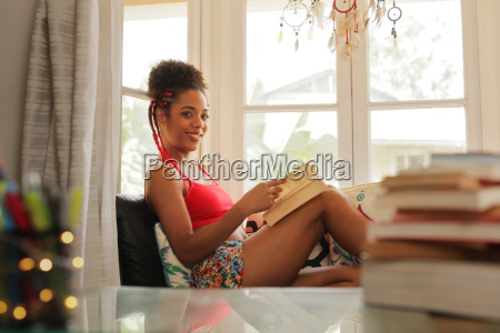 portrait black woman reading book and