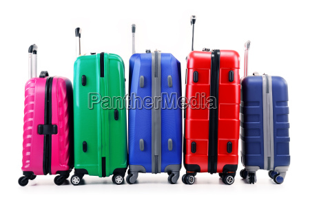 five plastic suitcases isolated on white