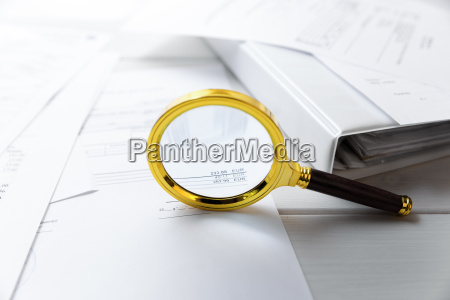 audit concept magnifying glass and