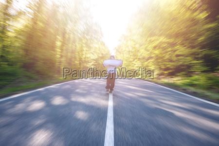 panning shot of boy walking through