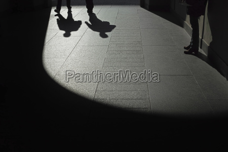 low section of people in shadow