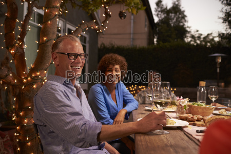 mature couple enjoying outdoor meal in