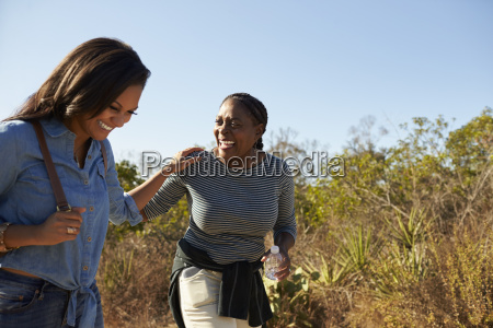 mother and adult daughter hiking outdoors