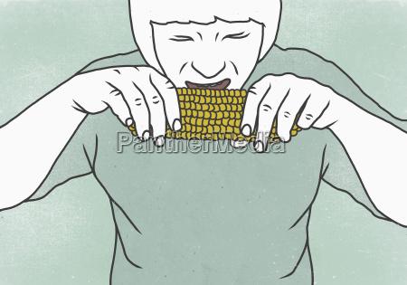 close up of man eating corn