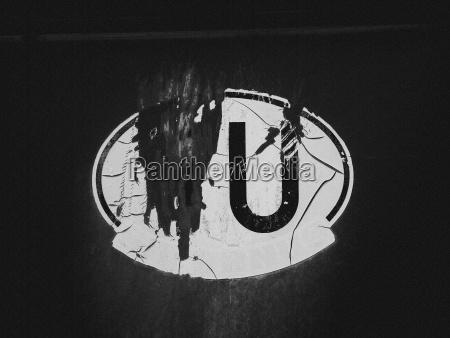 close up of damaged oval sticker