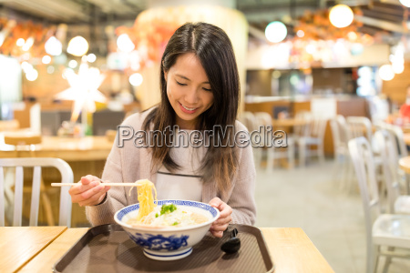 woman enjoy her japanese noodles in