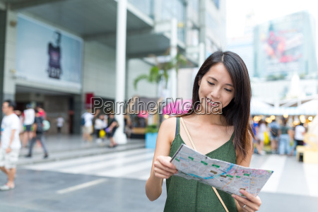 woman reading city map in bangkok