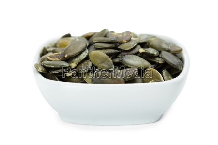roasted pumpkin seeds in white bowl