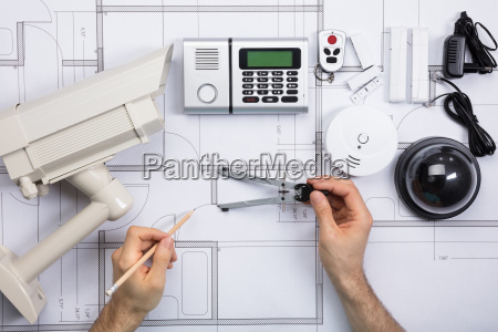 male engineer working on blueprint with