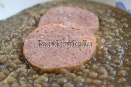 slices of cotechino in soup of