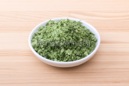 porcelain bowl with green herbal salt