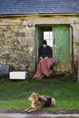 man sitting in the doorway of