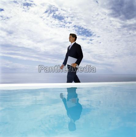a man in a suit walking