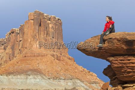 a woman sits on a terrace
