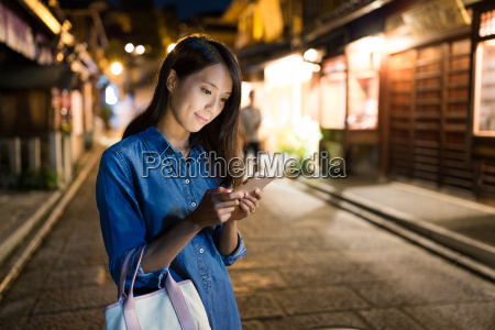 young woman searching on cellphone at