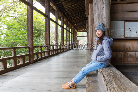 woman in japanese wooden house