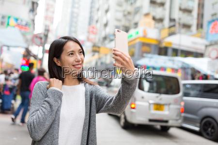 woman taking selfie in mongkok city