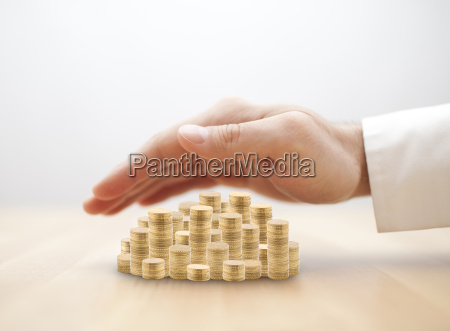 stack of golden coins covered by