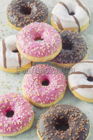 doughnuts with various glazes and sugar