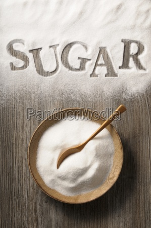sugar in a wooden bowl and